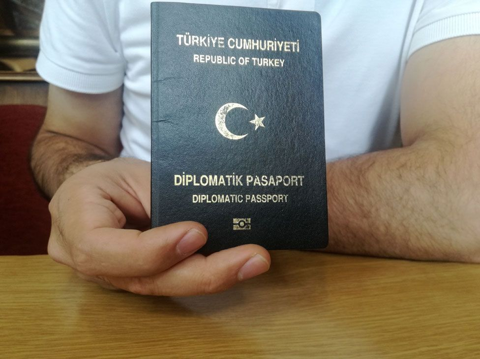 Military officer holding diplomatic passport