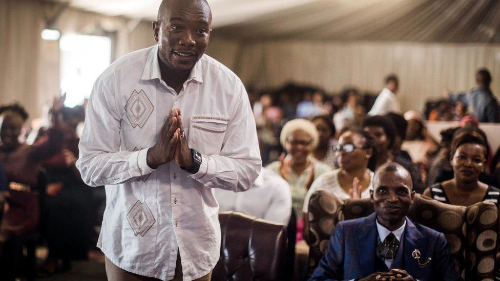 Mmusi Maimane greets the congregation at the Abundant Life Church in Kwamashu township outside of Durban on 17 March 2019, while on the campaign trail.
