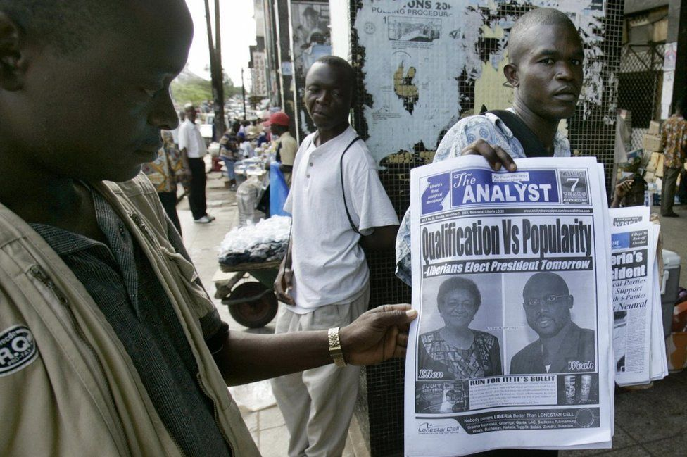 A Liberian street newsagent presents the front pages of a newspaper, 07 November 2005 in Monrovia, on the eve of the second round of the Liberian presidential election