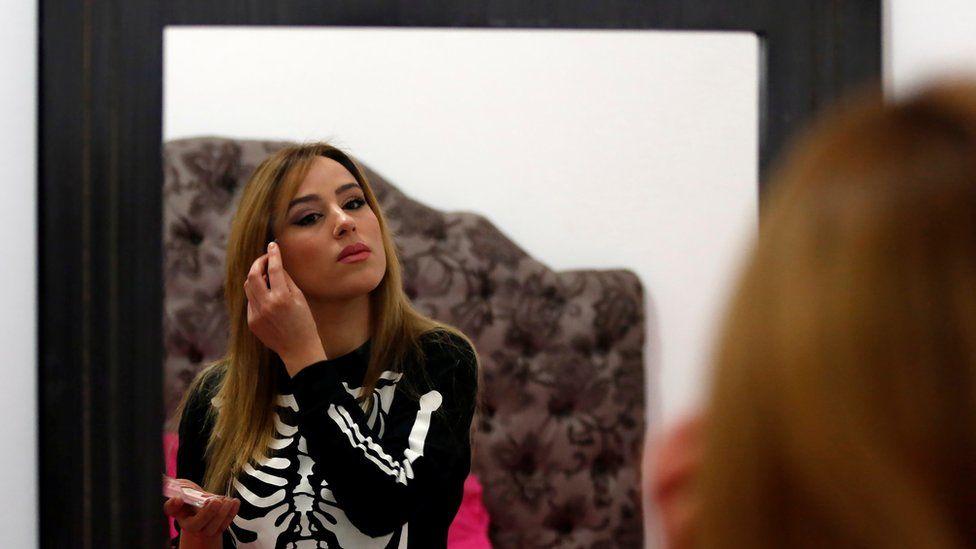 Tunisian belly dancer Nermine Sfar doing her make-up