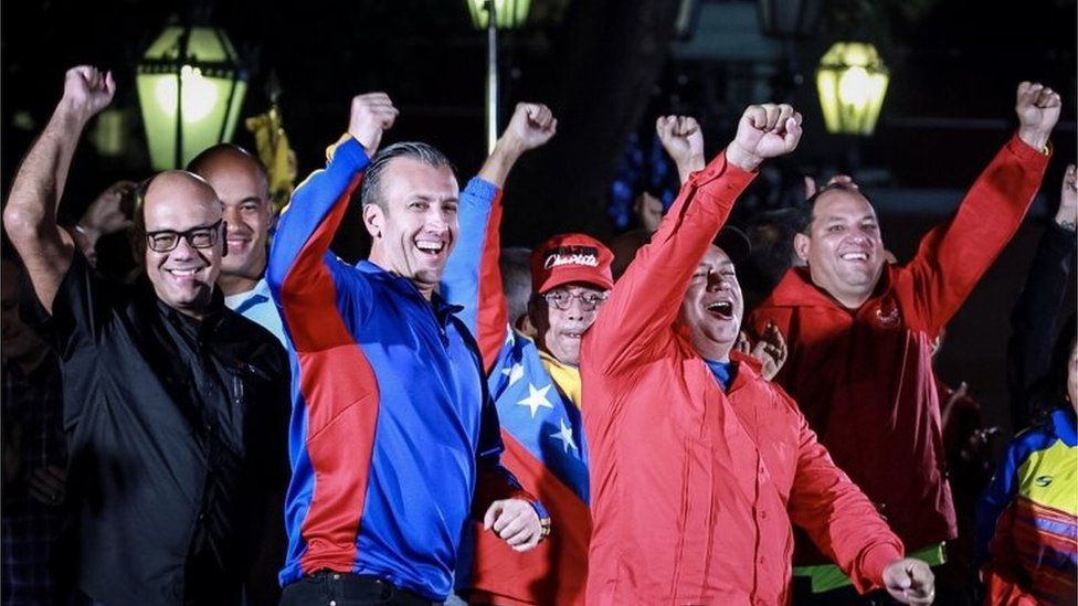 """The mayor of Caracas Jorge Rodriguez (L), The Vice President of Venezuela Tareck El Aissami (2-L), the Minister of Electrical Energy Luis Alfredo Motta Dominguez (C) and the first vice president of the ruling United Socialist Party of Venezuela (PSUV) Diosdado Cabello (2-R), attend an event celebrating the election results after a national vote on President Nicolas Maduro""""s proposed Constituent Assembly at Plaza Bolivar in Caracas, Venezuela, 31 July 2017"""