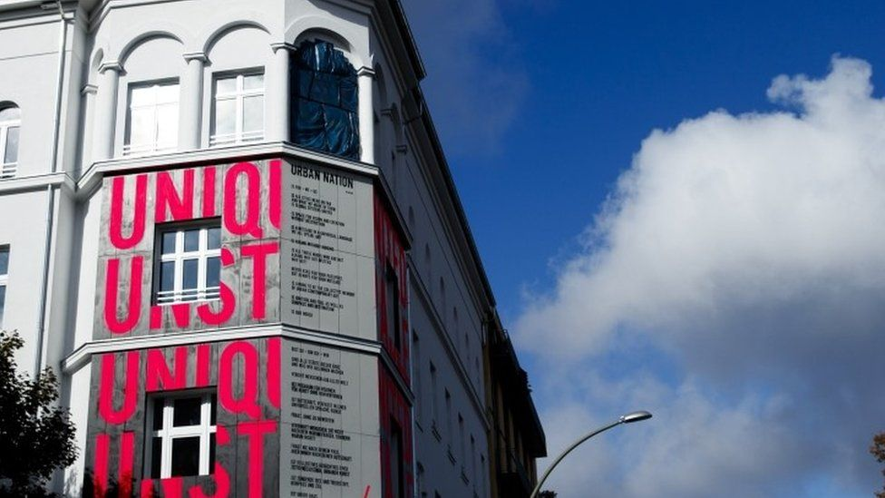 Pink coloured letters are painted at the wall at the Museum for Urban Contemporary Art in Berlin (15 September 2017)