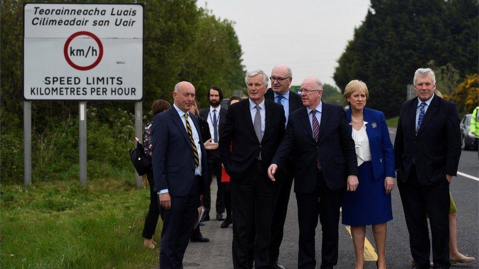 Irish ministers with EU delegation at the Irish border