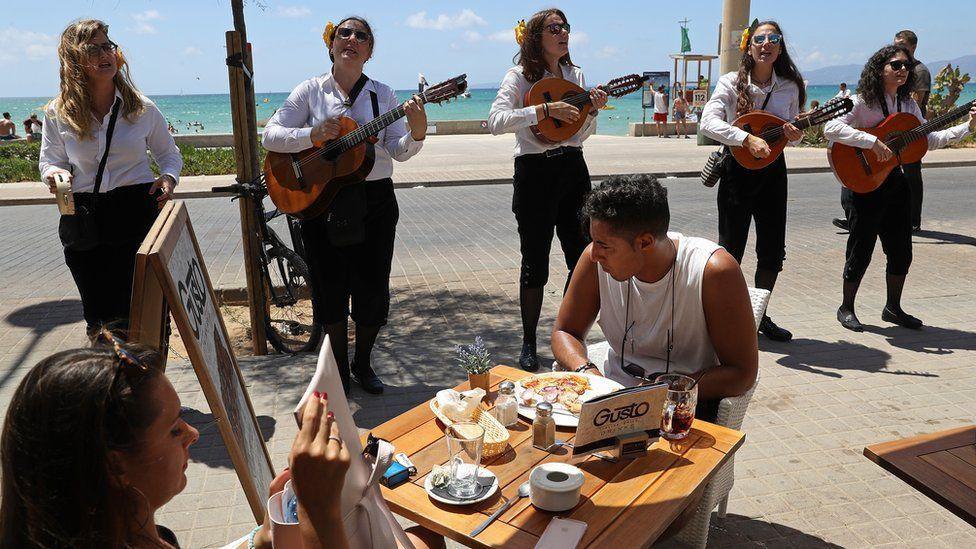 Spanish street musicians perform along the Ballermann stretch on 27 July 2017 in Palma de Mallorca, Spain