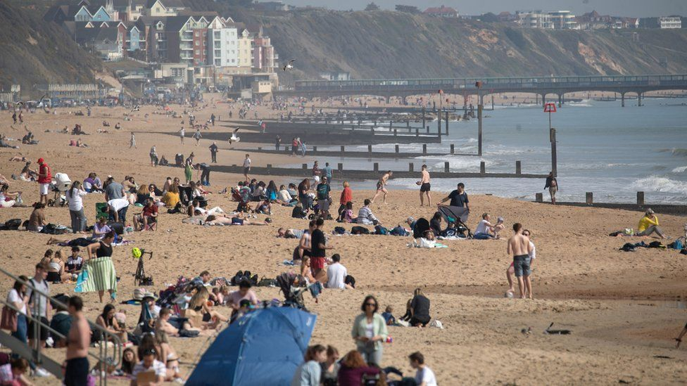 People enjoy the warm weather on Bournemouth beach in Dorset.