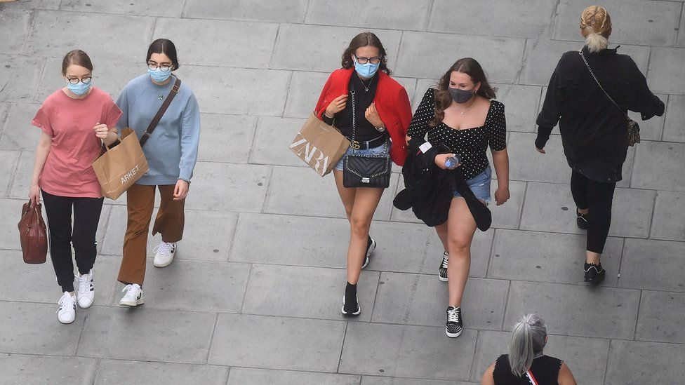 Shoppers in face masks on Oxford Street