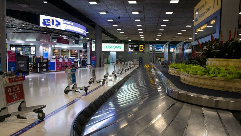 An empty luggage claim area in Bangkok, Thailand.