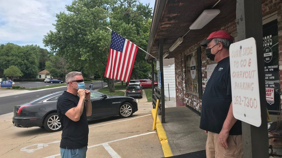 Bob Palmgren, the owner of RJ's Bob-Be-Que Shack, told a customer, Randy Treas, that he has to put on a mask