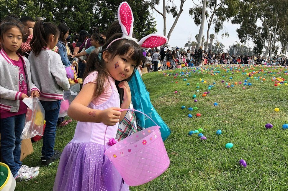 """Children prepare for a huge Easter egg hunt at Connection Point Church's sixth annual """"Eggstravaganza"""" in Torrance, California"""