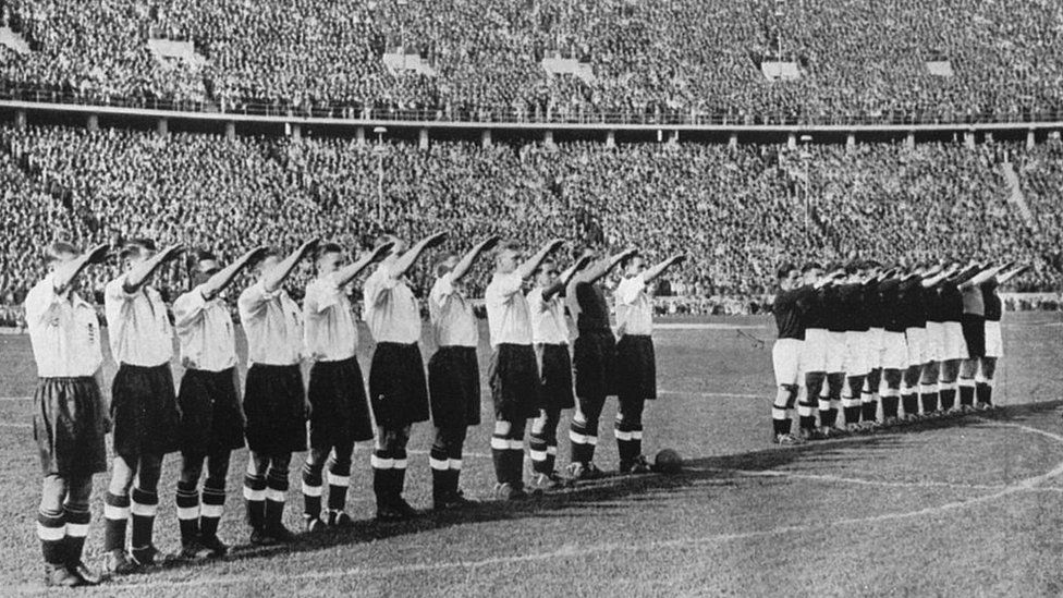England team (in white) give the Nazi salute in Berlin in 1938