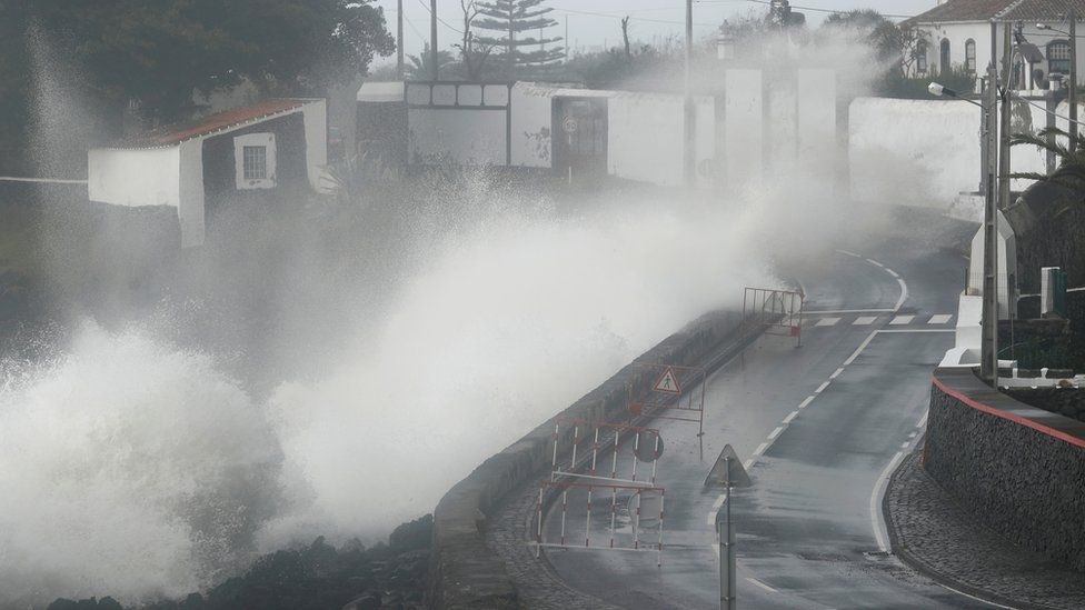 Waves generated from Lorenzo hit the coast of Sao Mateus in the Azores of Portugal