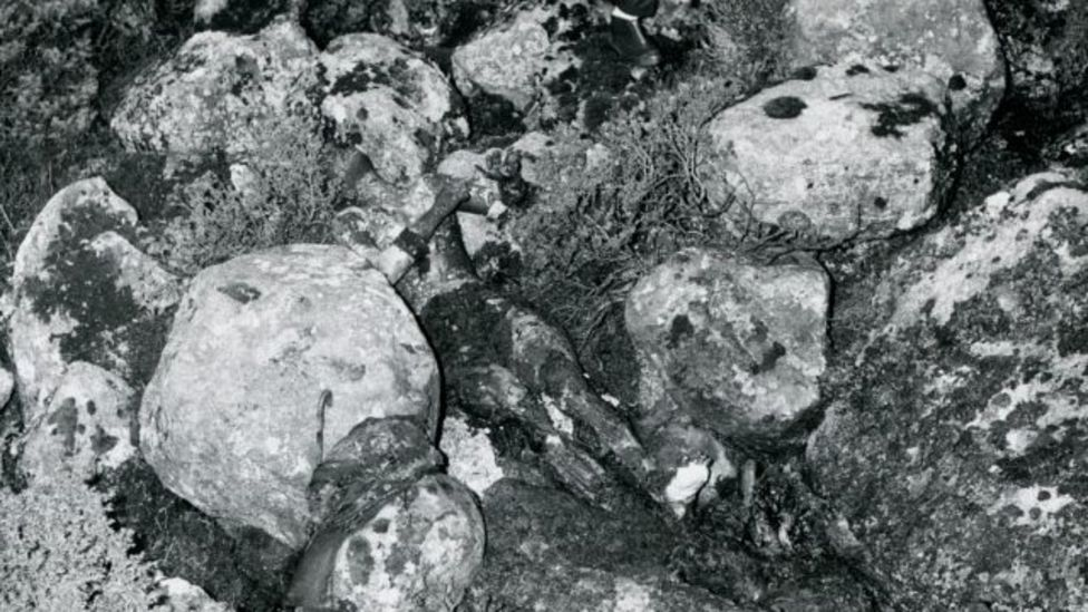 An archive photo showing the Isdal Woman's body lying across the rocks