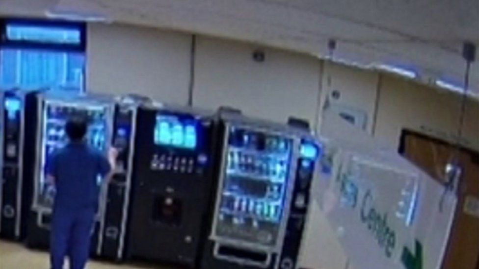Basharat using the stolen bank card at a vending machine