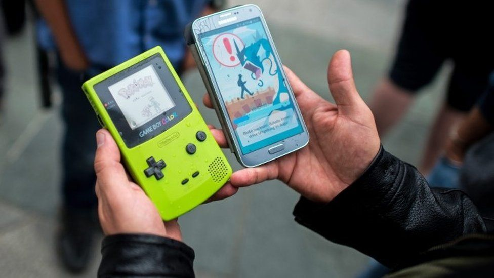 A gamer displays the Pokemon video game on a Game Boy (left) and the Pokemon Go app on a smartphone (right) - (16 July 2016)
