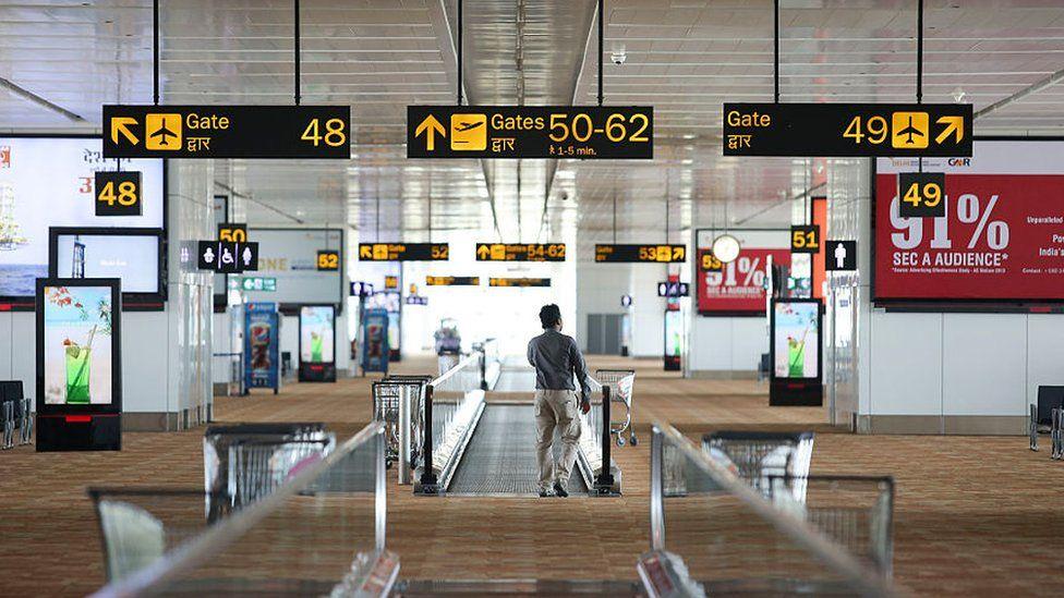 A man waiting at the airport