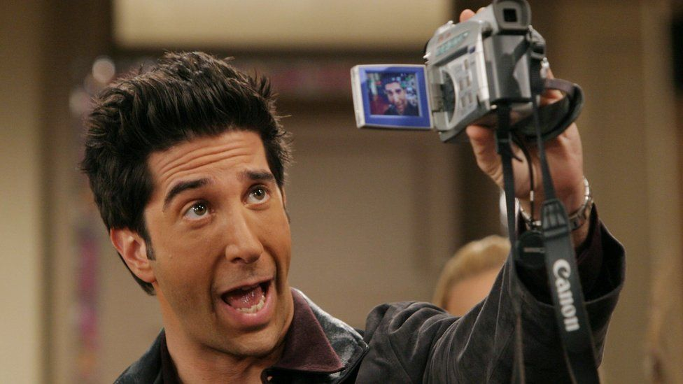 David Schwimmer as Ross pulls a face at a Camcorder