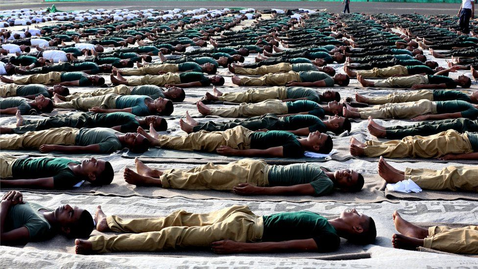 Indian Army personnel from the third Electronic Mechanical Engineering (EME) stream practice Yoga at a military station, to mark the World Yoga Day in Bhopal, India, 21 June 2017.