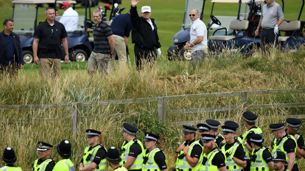 Donald Trump and police at the Turnberry golf course in Scotland