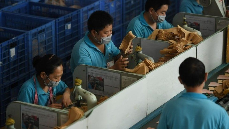 Workers on a production line at the Huajian shoe factory in Dongguan, in southern China's Guangdong province (14 September 2016)