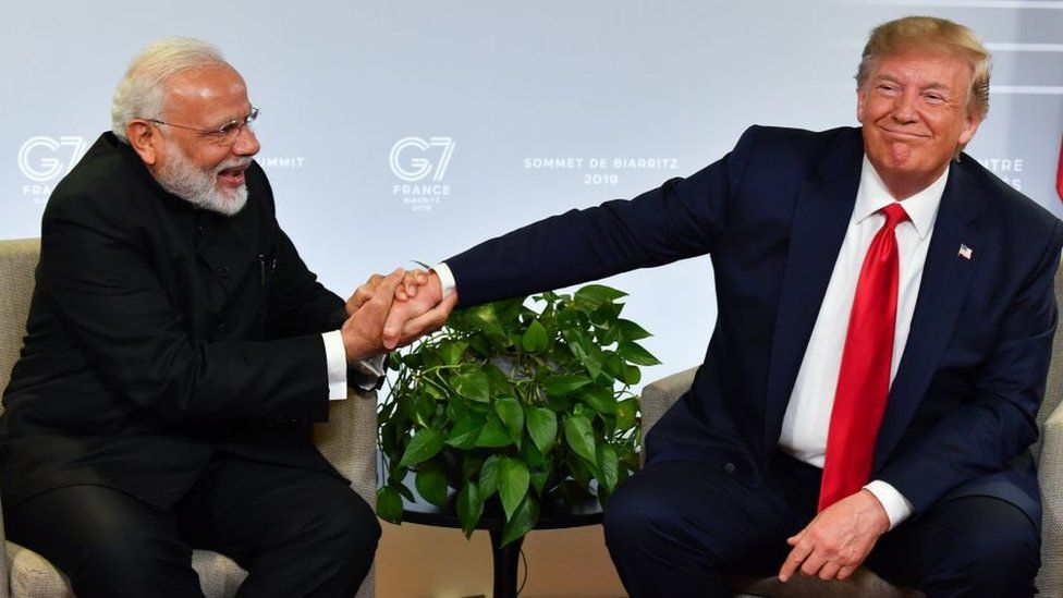 Indian Prime Minister Narendra Modi (L) and US President Donald Trump shakes hands as they speak during a bilateral meeting in Biarritz, south-west France on August 26, 2019.