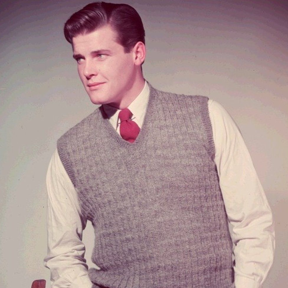 Roger Moore modelling a sweater in the 1950s