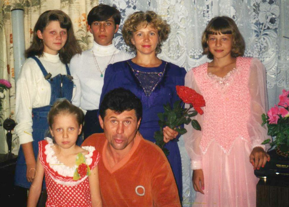 Stepanova (right) as a child - her father used to beat her mother and siblings