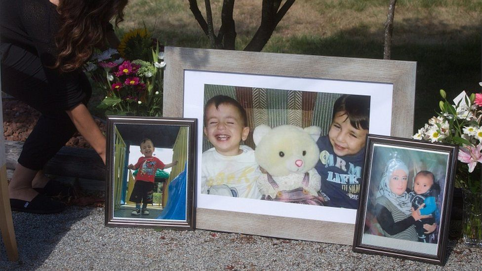 Photographs of late brothers Alan and Ghalib Kurdi and their mother displayed outside the home of their aunt Tima Kurdi, in Coquitlam, British Columbia, on 4 September 2015