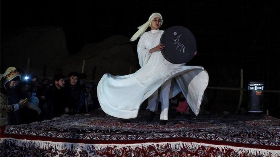 A dancer in a white dress performs near the site where the Salsal Buddha statue once stood
