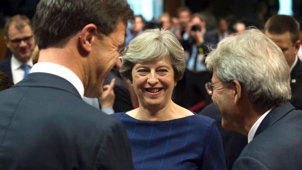 UK Prime minister Theresa May talks with Dutch Prime minister Mark Rutte (L) and Italian Prime Minister Paolo Gentiloni (R)