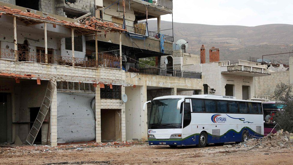 A convoy of buses arrives at the rebel-held town of Zabadani on 12 April 2017