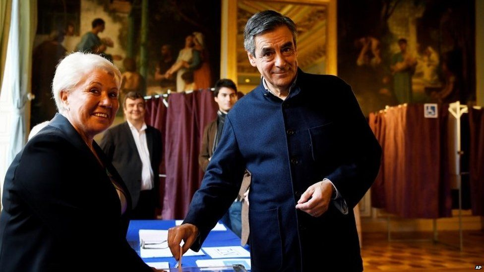 France's upcoming presidential primary election candidate of the right-wing party, Francois Fillon casts his vote at a polling station in Paris, Sunday, 27 November 2016, during the second round of the conservative primary election.