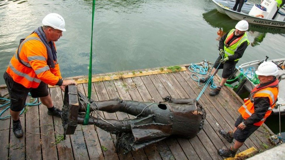 The statue of Edward Colston being retrieved from the harbour in Bristol, southwest England