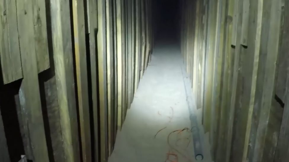 Tunnel lined with wood planks