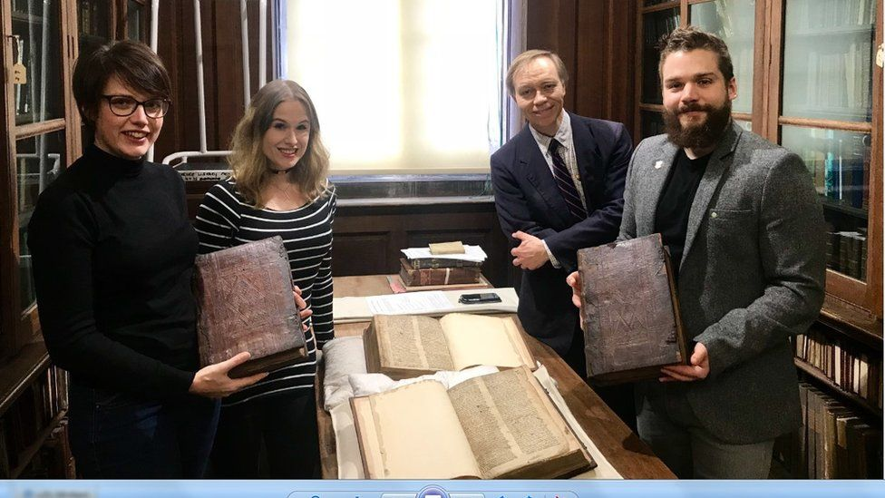 Leah Tether, Laura Chuhan Campbell, Michael Richardson and Benjamin Pohl with the books in Bristol Central Library's Rare Books Room