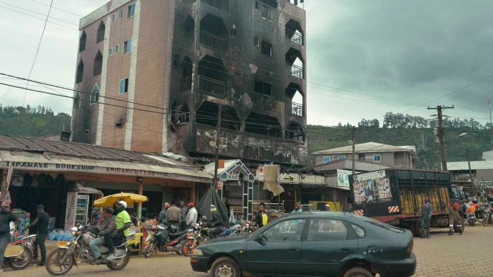 This photo taken on June 16, 2017 in Bamenda shows a hotel destroyed by a fire, allegedly attributed to a radical separatist movement demanding the independence of the Anglophone region from the rest of Francophone Cameroon.