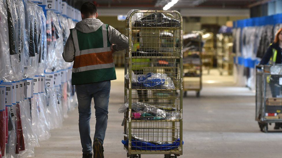 Worker in the Sports Direct warehouse in Shirebrook, Derbyshire