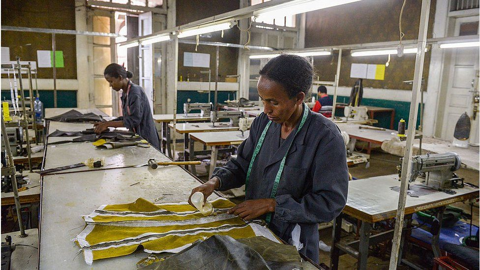 Women make clothes in a textile factory in Ethiopia