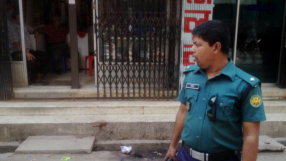 A Bangladeshi policeman stands guard at the site of the murder of a law student, hacked to death by four assailants the night before, in Dhaka on April 7, 2016