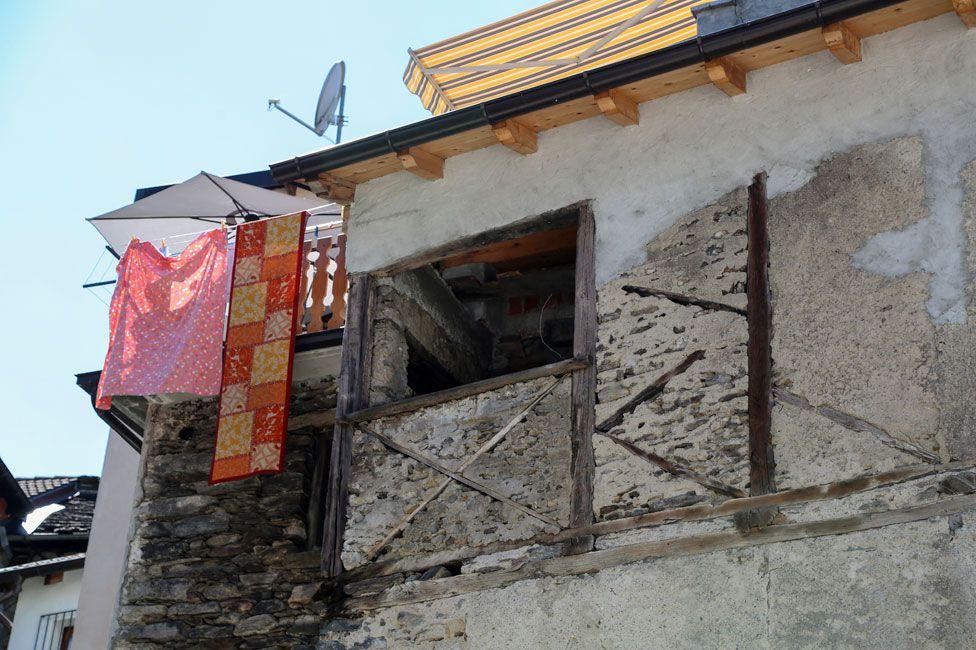 Wooden cross under a window