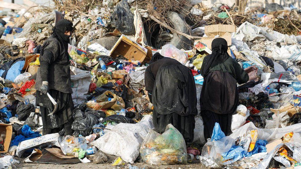 Iraqi women search for recyclable items at a rubbish dump in Baghdad, Iraq (6 May 2020)