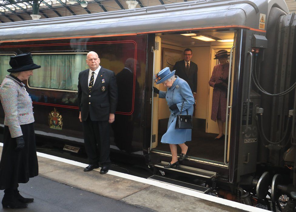 The Queen getting off the Royal Train