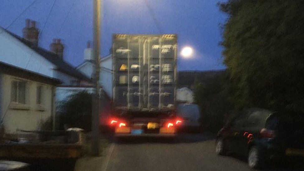 A lorry appears stuck on a narrow road in Gilwern
