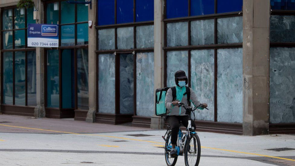 A courier cyclist in Cardiff during lockdown