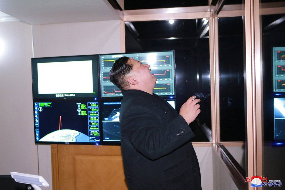 North Korea's leader Kim Jong Un is seen as the newly developed intercontinental ballistic rocket Hwasong-15's test was successfully launched, in this undated photo released by North Korea's Korean Central News Agency (KCNA) in Pyongyang 30 November 2017.