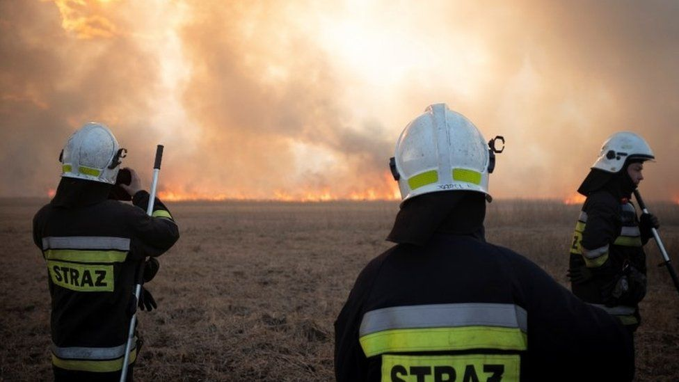 Firefighter attacks flames in Poland