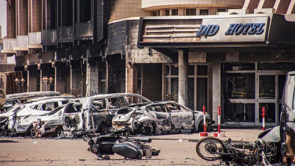 Damaged vehicles outside the Splendid Hotel in Ouagadougou, Burkina Faso, 16 January 2016