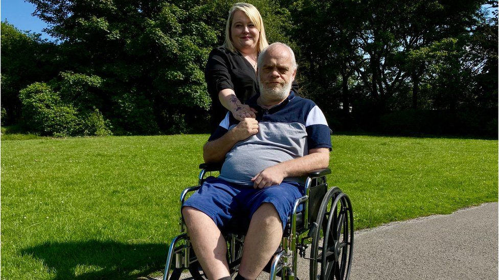 Taxi driver Darren Hiles with his partner Heidi Neilson