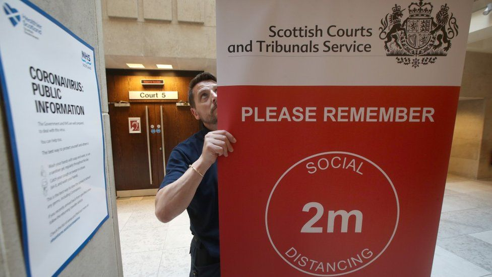 social distancing sign at court