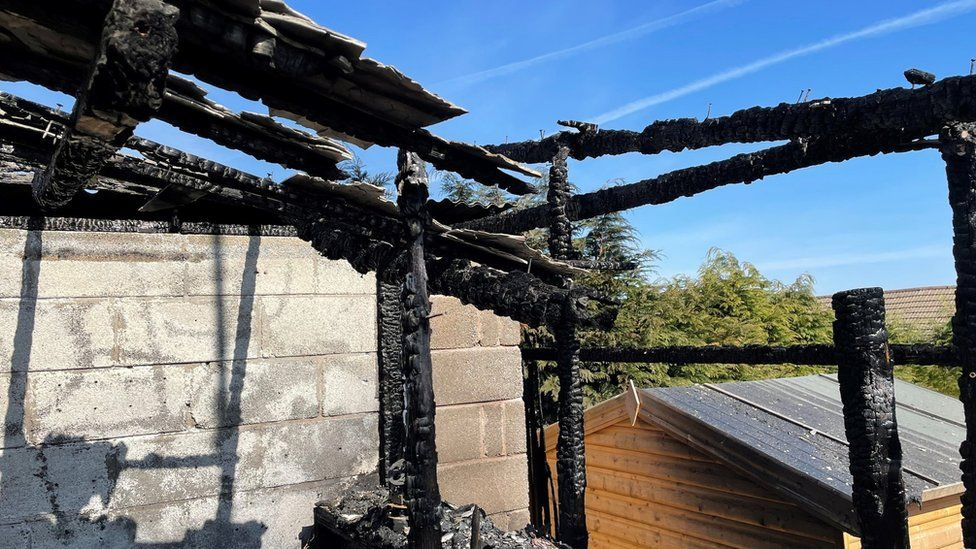 The burnt out shed