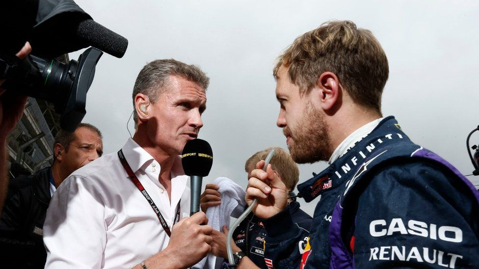 David Coulthard, while working for the BBC, interviews Seb Vettel of Red Bull